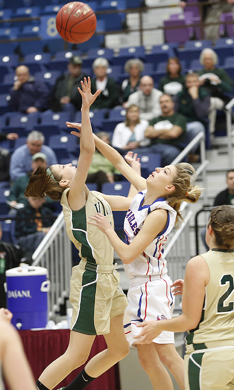 Anna Winslow, left, of Oxford Hills fouls Olivia Swan of Mt. Ararat as Swan goes up for a shot Friday in their Eastern Class A quarterfinal at Augusta. Swan scored 16 points in a 51-37 victory.