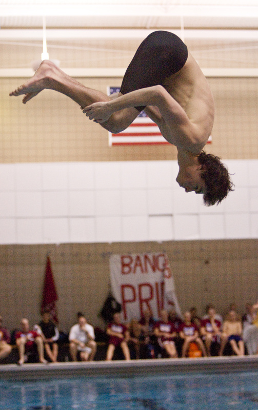 Michael Gordon, a Cheverus senior, performs a dive during the 1-meter competition at Bowdoin on Monday. Gordon earned a third place in the diving competition.