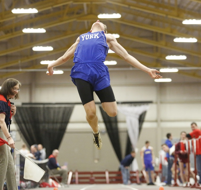 Derek Davis/Staff Photographer Joe Vogel of York soars into the pit while competing in the long jump Monday at the Class B indoor track championships in Lewiston. Vogel finished third, helping York to a second consecutive state championship.