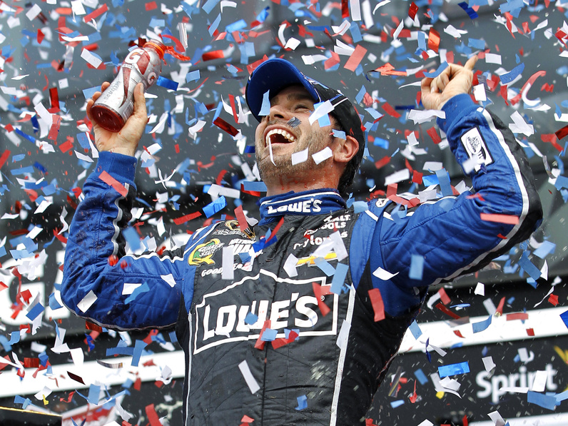 Jimmie Johnson celebrates after winning the Daytona 500 NASCAR Sprint Cup Series auto race Sunday at Daytona International Speedway in Daytona Beach, Fla.