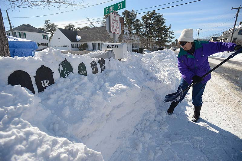 Pat Dunn of Pine Point shovels out mailboxes at the end of Pine Street in Pine Point on Sunday.