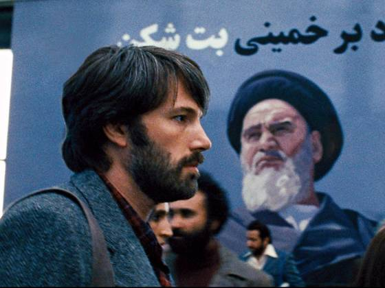In this image from the Oscar-winning film 'Argo,' the protagonist Tony Mendez, portrayed by Ben Affleck, walks past a mural in Tehran, Iran depicting the Ayatollah.