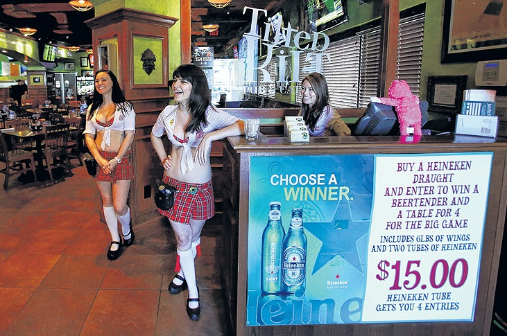 Tilted Kilt Pub & Eatery employees, from left, Kimi Hyde, Aileen Suseck and Shara Cail talk to patrons at the restaurant in Orlando, Fla. The chain is part of a dining sector featuring scantily clad waitresses. 04000000 08000000 FIN HUM krtbusiness business krtfeatures features krthumaninterest human interest krtnational national krtedonly mct 04014004 10003000 krtfood food krtleisure leisure lifestyle life krtnamer north america krttourism tourism krtusbusiness LIF restaurant TOUR u.s. us united states 08002000 curiosity ODD 2013 krt2013