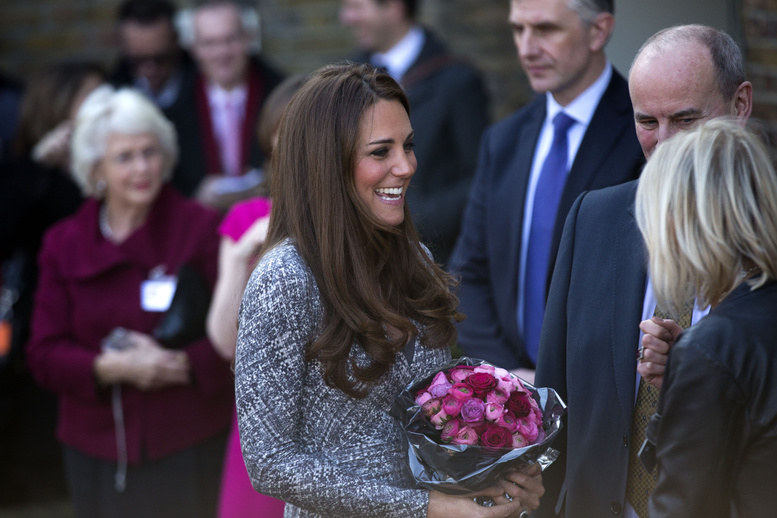 Britain's Kate, the Duchess of Cambridge, receives a bouquet of flowers Tuesday after a visit to Hope House in London, a place for women to recover from addiction, one of the causes for which she is a patron.