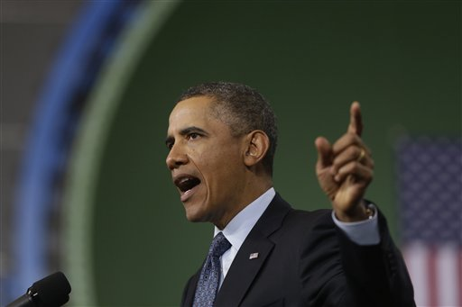 President Barack Obama warns of automatic defense budget cuts during a visit to Newport News Shipbuilding on Tuesday.