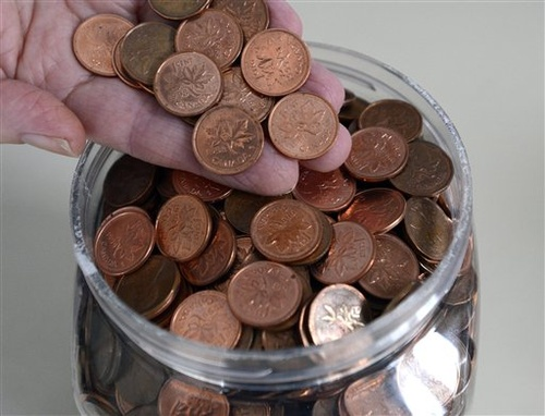 The household penny jar may soon become a thing of the past in Canada. The phasing-out of the penny began Monday at the Royal Canadian Mint.