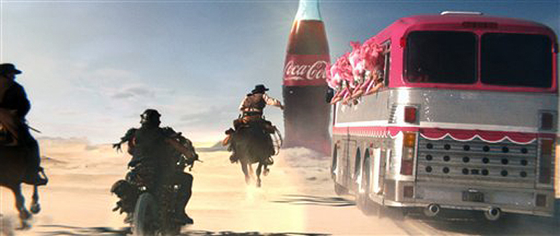 Coca-Cola created an ad based on an online campaign that pits three groups — a troupe of showgirls, biker style badlanders and cowboys — against each other in a race through a desert for a Coke.
