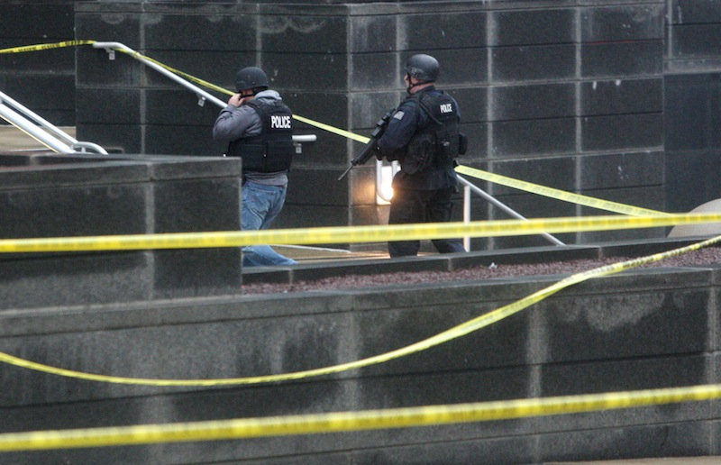 Heavily armed police enter the New Castle County Courthouse, Monday morning, Feb. 11, 2013 in Wilmington, Del. The mayor of Wilmington, Del., says a man suspected of killing his wife and wounding two others at the New Castle County Courthouse has been killed by police. (AP Photo/The News Journal/William Bretzger) courthouse shooting