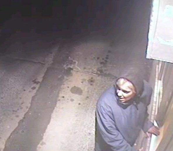 Surveillance image of suspect at Dunkin' Donuts drive-through.