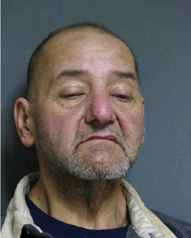 This booking photo released by Vermont State Police shows Mark Mumley, 52, of Alburgh, Vt. Authorities said four suspects, including Mumley, stole items including more than $200,000 in gold coins from a vacant home in Alburgh after its eccentric owner died in a farm accident last year. Mumley, Shawn Farrell, 41, and Ricky Benjamin, 35, were arraigned and held on $75,000 bail. A fourth suspect, Jennifer Jarvis, 32, was released after being issued a citation. (AP Photo/Vermont State Police)
