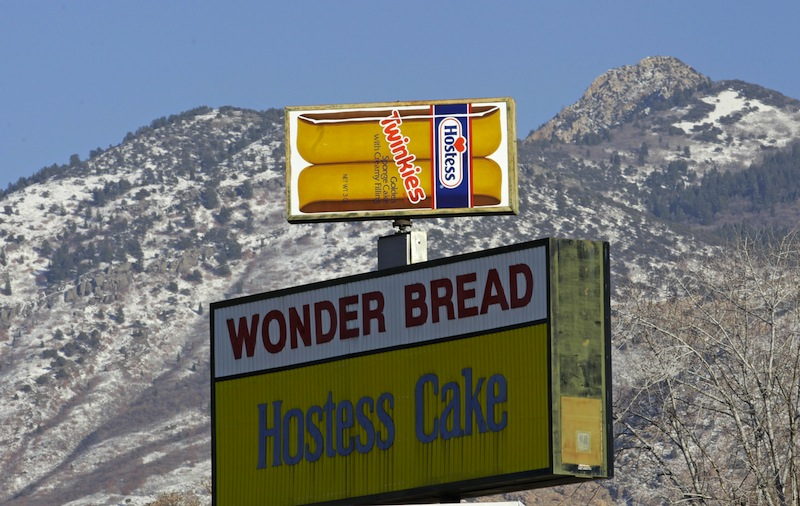 A Hostess Twinkies sign is shown at the Utah Hostess plant in Ogden, Utah, Thursday, Nov. 15, 2012. Hostess Brands Inc. confirmed on Thursday that Flowers Foods will acquire the bulk of Hostess' bread business for $360 million after no other qualified bids were received. (AP Photo/Rick Bowmer)