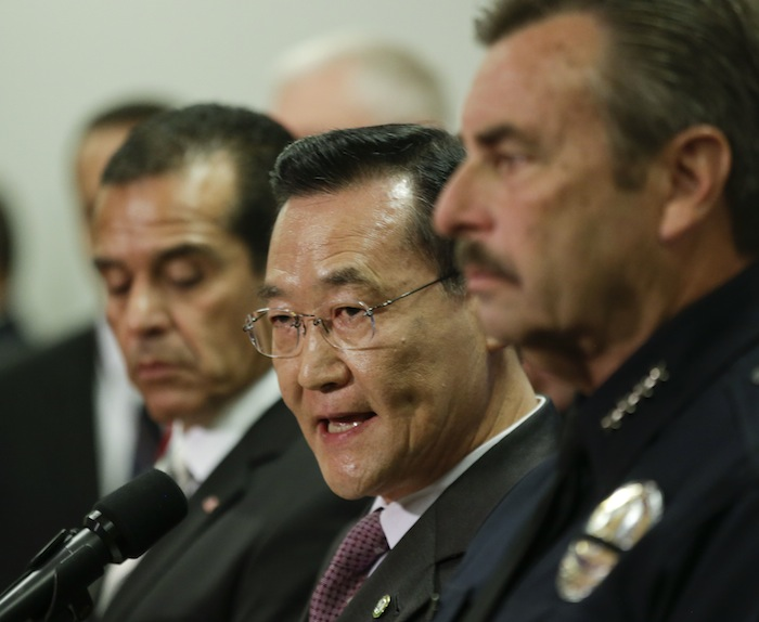 Irvine, Calif., Mayor Steven Choi, center, talks about the $1,000,000 reward for accused killer and fired Los Angeles police officer, Christopher Dorner as Los Angeles Mayor, Antonio Villaraigosa, left, and Los Angeles Police Chief Charlie Beck look on during a new conference at the Los Angeles police department in Los Angeles, Sunday, Feb. 10, 2013. (AP Photo/Chris Carlson)