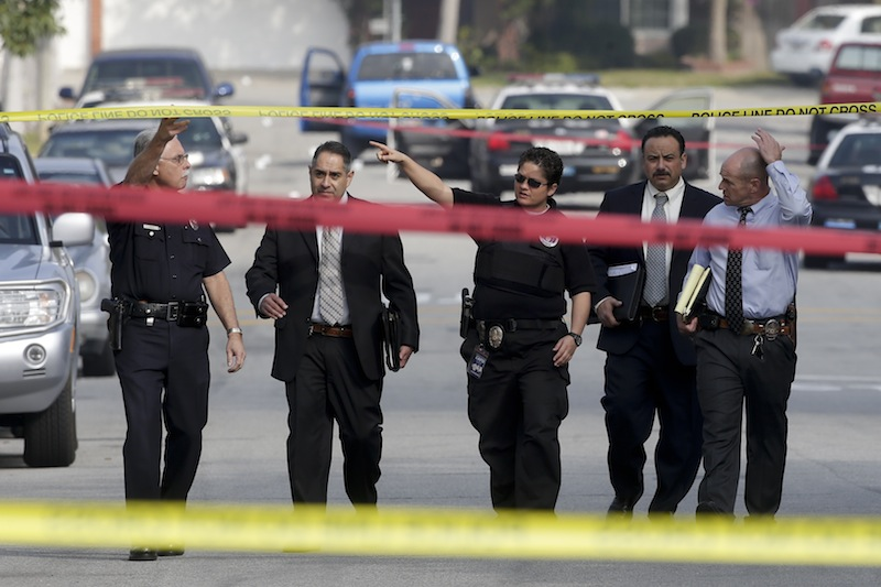 Law enforcement members look over the scene of an shooting linked to ex-cop Christopher Dorner in Torrance, Calif., on Feb. 7. The death of the ex-Los Angeles police officer in a fiery standoff with authorities has done little to quell online chatter over a man whose rampage against law enforcement created a small but vocal following.