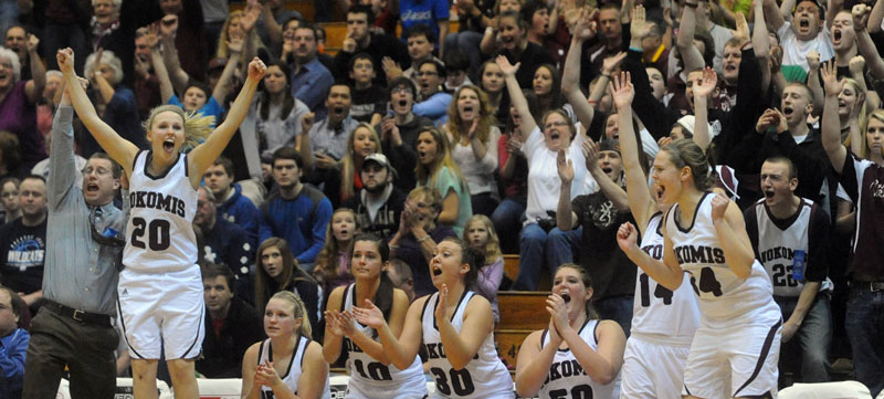 Nokomis players and coaches cheer a 3-pointer that tied the game late in the fourth quarter Wednesday in an Eastern Class B quarterfinal against Camden Hills at the Bangor Auditorium. Nokomis won, 45-40.