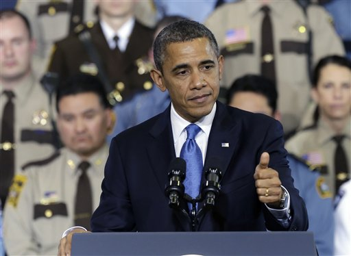 President Barack Obama gestures as he speaks about his gun violence proposals on Monday at the Minneapolis Police Department's Special Operations Center in Minneapolis, where he outlined his plan before law enforcement personnel.