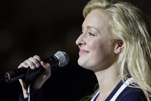In this undated file photo, country singer Mindy McCready performs in Nashville, Tenn. McCready, 37, was found dead Sunday with what appears to be a single, self-inflicted gunshot wound, according to a news release from the Cleburne County, Ark., Sheriff's Office.