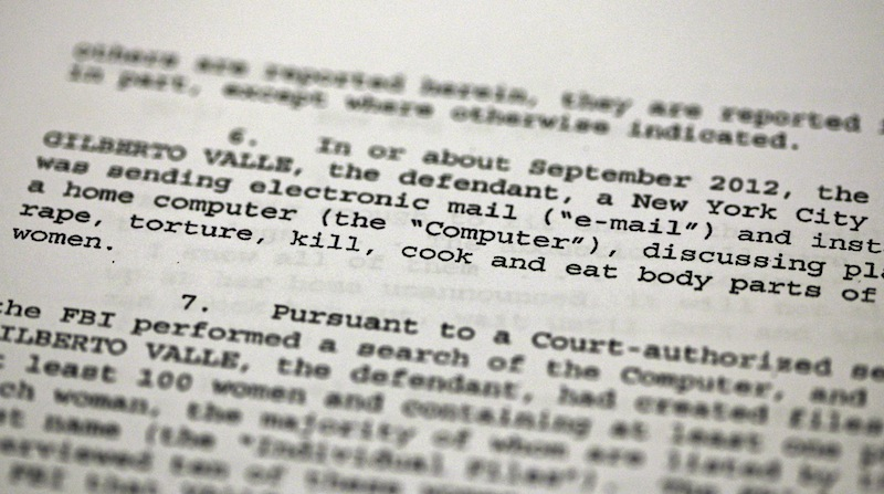 This Oct. 25, 2012 file photo shows a passage of a Federal complaint filed in New York, against New York City Police Department officer Gilberto Valle. Valle is accused of kidnapping conspiracy and admits to thinking about abducting, cooking and devouring young women. His own lawyer has shown prospective jurors a kinky staged photo of a woman trussed up in a roasting pan to test their tolerance for the officer's