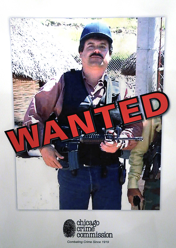 """A poster at a Chicago Crime Commission conference in Chicago shows Mexican drug lord Joaquin """"El Chapo"""" Guzman. It is the first time since Prohibition that anyone other than the infamous 1930s gangster Al Capone has been named Public Enemy No. 1."""