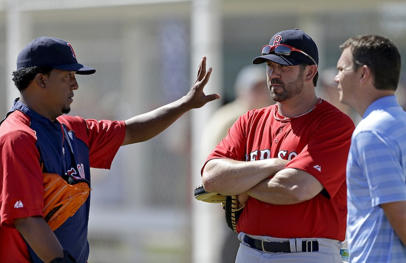 Former Boston Red Sox pitcher Pedro Martinez, left, and former catcher and captain, Jason Varitek, center, both now special assistants to the team, speak with general manager Ben Cherington, right, during a spring training baseball workout, Wednesday, Feb. 20, 2013, in Fort Myers, Fla. (AP Photo/David Goldman)