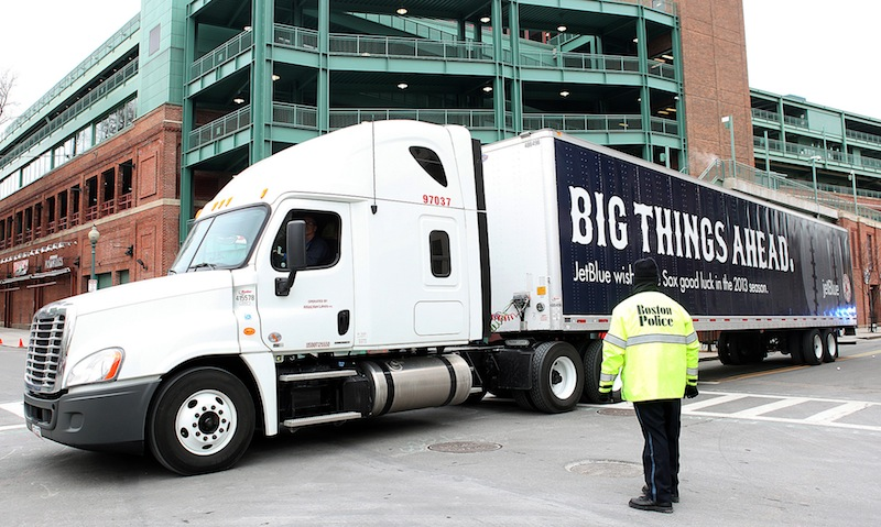 The truck full of Boston Red Sox baseball gear departs Fenway Park in Boston for Spring Training in Florida on Tuesday, Feb. 5, 2013. Red Sox fans turned out for 'Truck Day' at Fenway, the day the team sends off its equipment to Florida in preparation for spring training. Pitchers and catchers formally report to spring training a week from today but already, some players have been working out in Fort Myers. (AP Photo/The Boston Herald, Angela Rowlings) Fenway Park;Truck Day;Spring training;Boston Red Sox