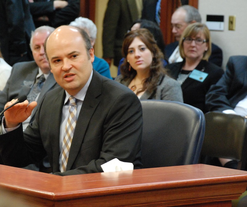 David Hosmer, a Yankton, S.D., lawyer who represents people with mental illnesses, testifies to the South Dakota House Health and Human Services committee on Tuesday, Feb. 19, 2013, in Pierre, S.D., on a bill that would have prevented people involuntarily committed for mental health treatment and declared dangerous to others from having guns. Hosmer supported the bill, but the committee rejected it. (AP Photo/Chet Brokaw)