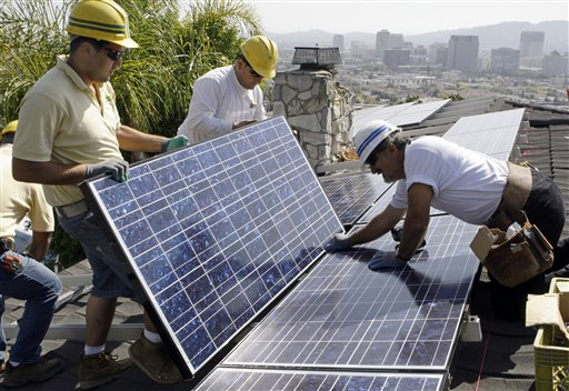 Installers Arin Gharibian, left, Hayk Mkrtchayan, center, and team leader Edward Boghosian, all employees of California Green Design, assemble solar electrical panels on the roof of a home in Glendale, Calif., in 2010. Fueled partly by billions of dollars in government incentives, the solar panel industry is creating millions of solar panels each year and, in the process, millions of pounds of polluted sludge and contaminated water.