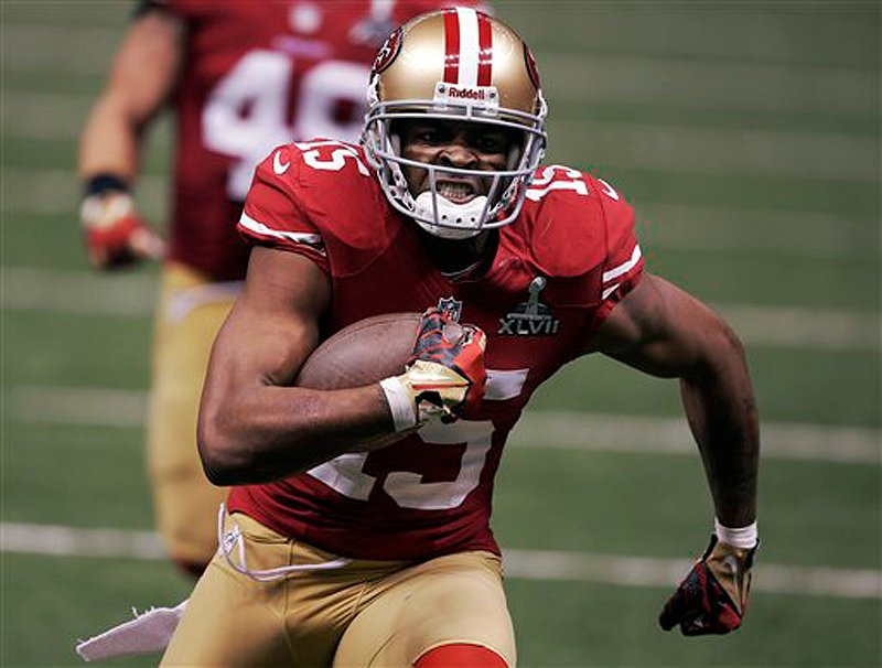 San Francisco 49ers wide receiver Michael Crabtree (15) scores on a 31-yard touchdown reception against the Baltimore Ravens during the third quarter of Super Bowl XLVII Sunday in New Orleans.