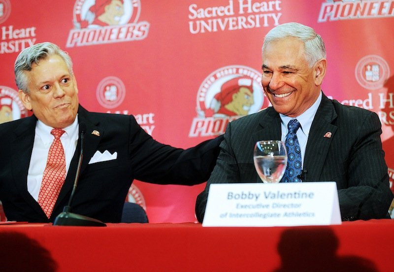 Senior Vice President of Athletics and Student Affairs James Barquinero, left, introduces Bobby Valentine during news conference at Sacred Heart University in Fairfield, Conn., Tuesday, Feb. 26, 2013. Valentine has been named executive director of Intercollegiate Athletics at Sacred Heart. (AP Photo/The Connecticut Post, Brian A. Pounds) Brian A. Pounds;pounds;connecticut post;connpost.com
