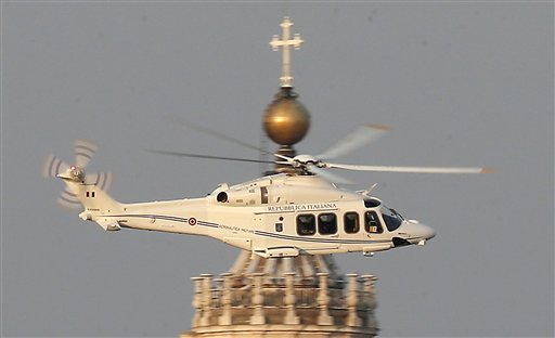 A helicopter with Pope Benedict XVI onboard leaves the Vatican in Rome on Thursday.