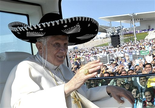 Pope Benedict XVI waves from the popemobile wearing a Mexican sombrero as he arrives to give a Mass in Bicentennial Park near Silao, Mexico, in this March 25, 2012, photo.