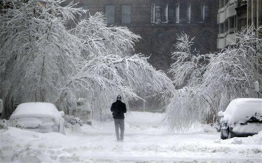 A pedestrian braves the storm in Kansas City, Mo., on Tuesday.