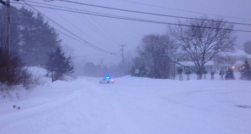 Gorham police block the intersection of State Road 114 and Huston Road at 6:30 a.m. Saturday due to a slideoff farther north on 114.
