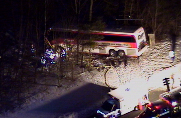 This photo of the bus crash scene Tuesday night in Georgetown, Mass., was taken from a Massachusetts State Police helicopter.