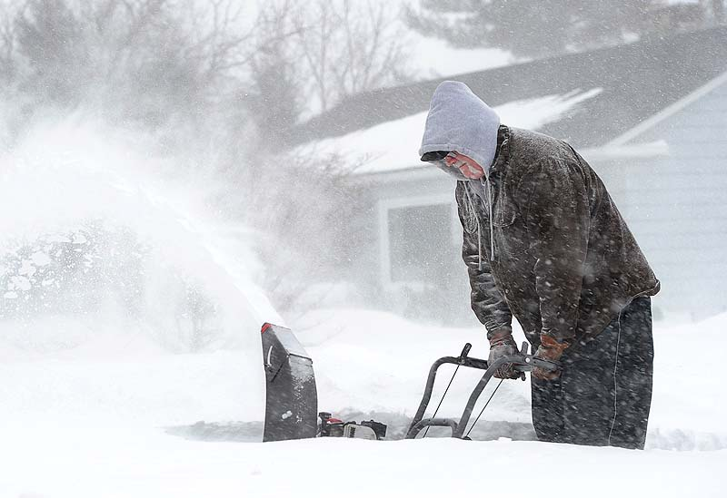 Charles Harris clears snow from his drive in Gorham on Saturday.
