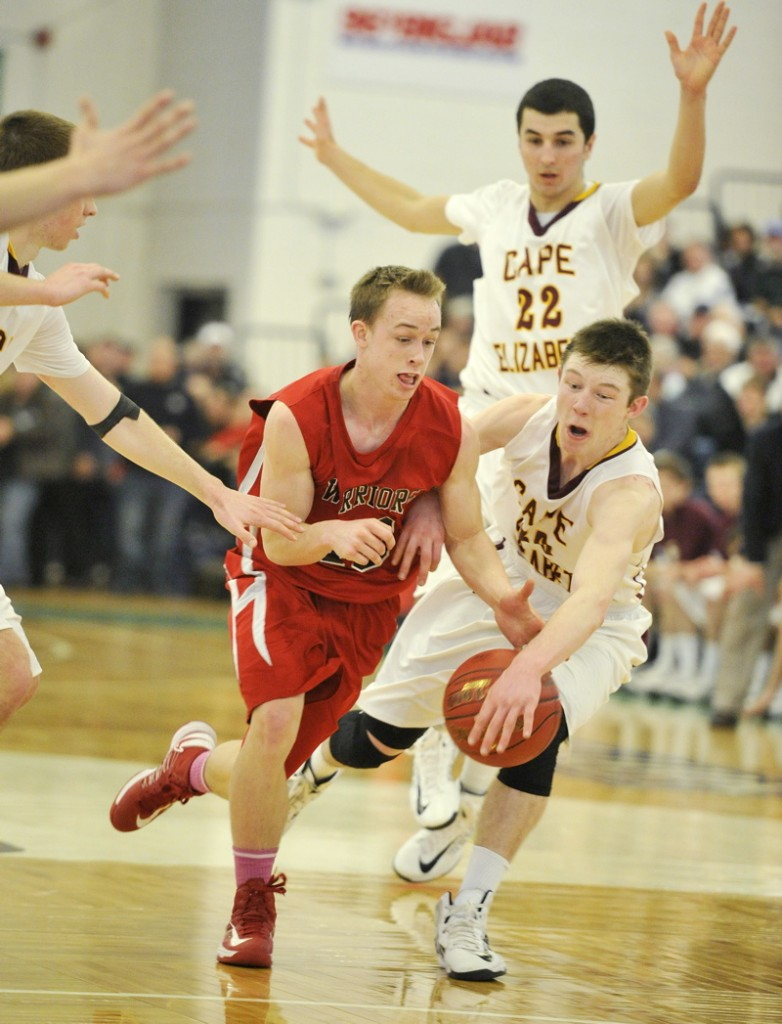 Eddie Galvin, right, of Cape Elizabeth tries to steal the ball from Jake Moody of Wells during their Western Class B quarterfinal Saturday at the Portland Expo. Third-seeded Cape Elizabeth won, 57-51.