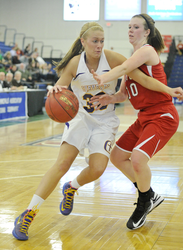 Kylie Libby of Cheverus looks to drive past Samantha Adams of Sanford during their quarterfinal. Cheverus advanced with a 31-26 victory.