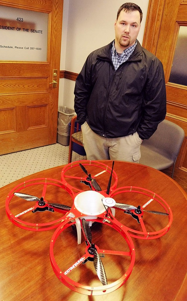 Christopher Taylor, president and drone designer for Viking Unmanned Aerial Systems, of Limington, talks about his company's FR-Xtreme drone model, which is on table, on Tuesday at the State House in Augusta.The company's website calls it a