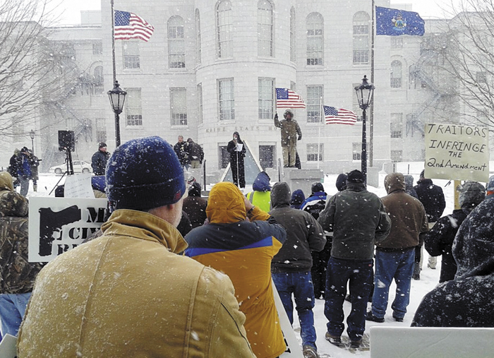 Rep. Deborah Sanderson, R-Chelsea, speaks to at a gun rally outside the State House on Friday.