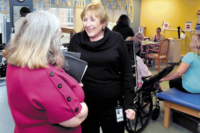 Sara Sylvester, right, administrator at the Oak Grove Center in Waterville, speaks with employee Betty Bayley in a rehabilitation unit on Thursday. Sylvester said that the facility is concerned about funding shortfalls that could impact staffing.