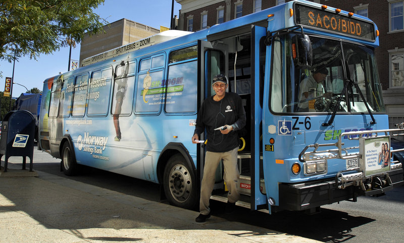 A man exits the Zoom bus at Portland City Hall in this 2011 file photo. The Zoom bus to Biddeford and Saco is one of several regional transit lines that travel on Congress Street and hope to benefit from bus stop improvements on the route.