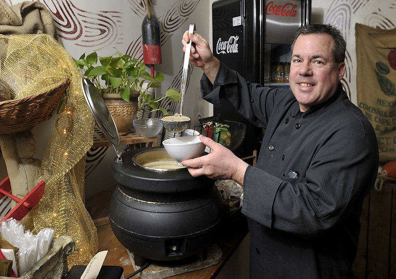 Owner Karl Whipple fills a bowl with his very popular portabella mushroom soup for a customer at Whip's Right Time Cafe.