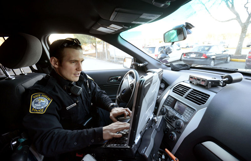 South Portland Police Officer Kevin Sager enters vehicle information into his computer to issue a ticket for an illegally parked car at the Maine Mall on Thursday, Jan. 31, 2013.