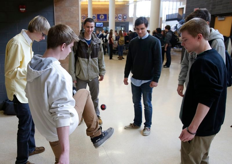 """Students play hackie sack to relax during a 20-minute """"recess"""" at Chanhassen High School in Chanhassen, Minn."""