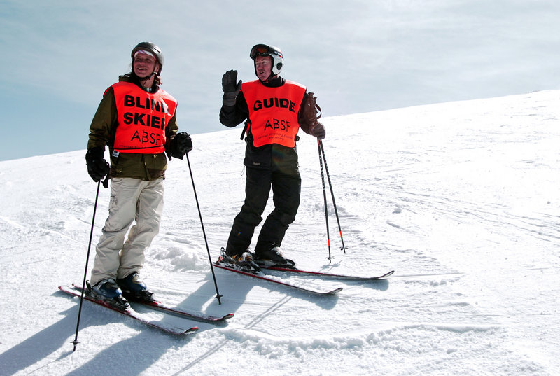 Wally Mozdzierz, left, of Chicago, relies on his guide – this time, Joe Ferrick – to negotiate the slopes and have a full day of skiing despite his vision disability.