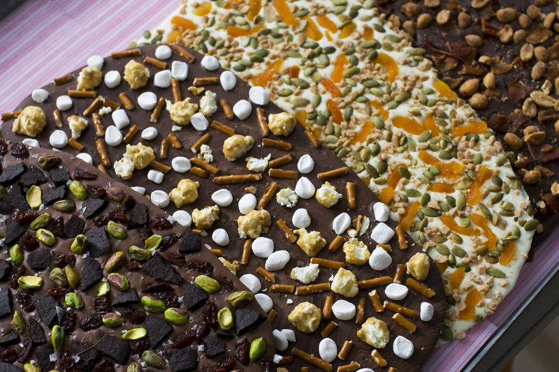 Four variations of Valentine's Day chocolate bark. You can top the chocolate with whatever your love loves.