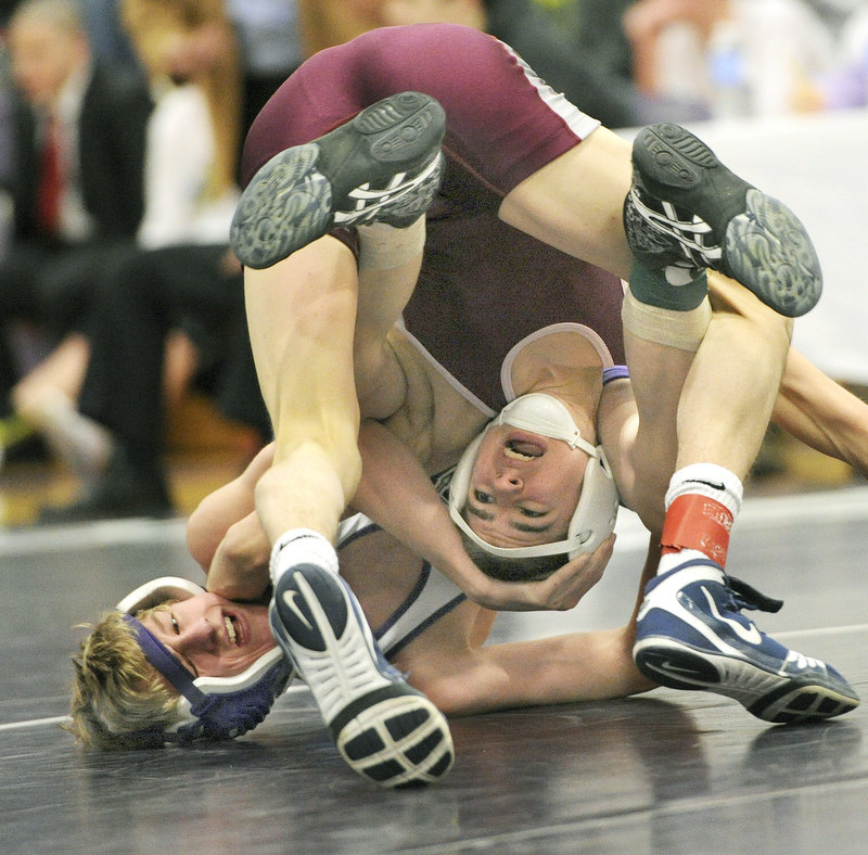 Joe Langley of Noble gets an upside-down look at the meet Saturday while being held by Darren LaPointe of Marshwood in their consolation final in the 106-pound class at the Western Class A championships. LaPointe won, 5-0.