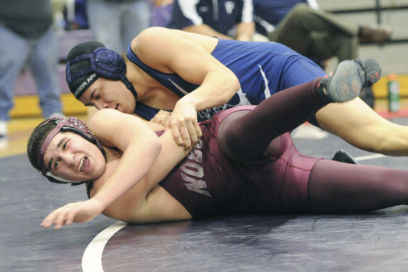 Jamal Durrani of Noble looks for the sideline while competing against Malcolm Henry of Portland in the 182-pound class. Henry won, then captured the consolation final.