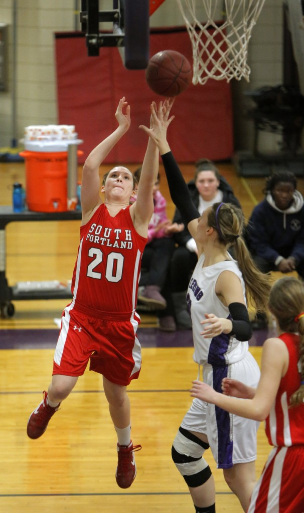 Meaghan Doyle of South Portland puts up a shot past Deering's Marissa MacMillan Monday night. Deering won with its defense, 33-21.