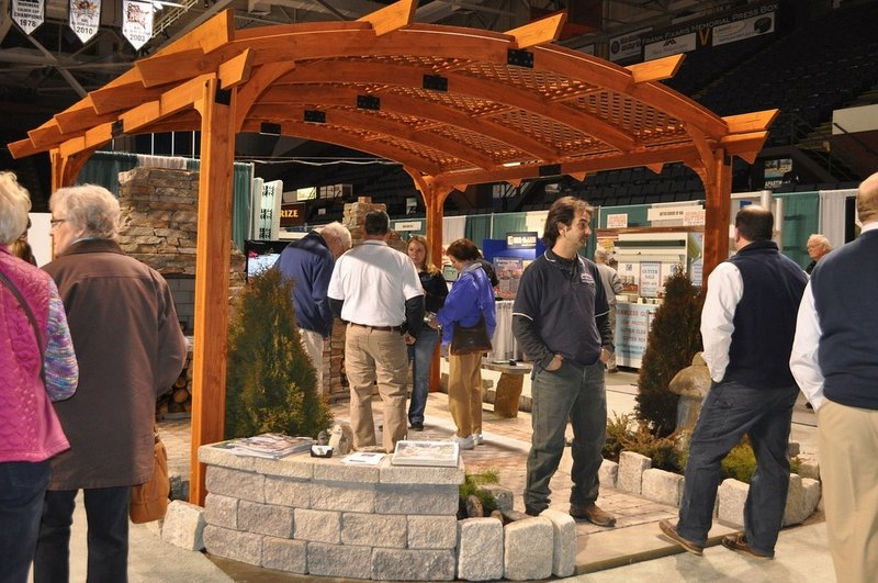 Visitors to last year's show take in the exhibits near an arbor display.