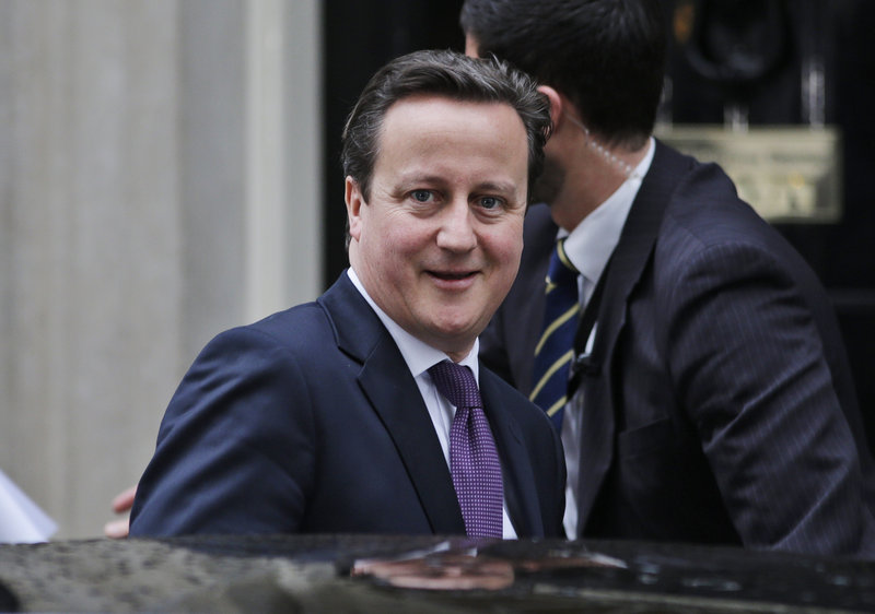 Prime Minister David Cameron, who championed a bill to legalize same-sex marriage in Britain, leaves his residence Tuesday on his way to address lawmakers in Parliament.
